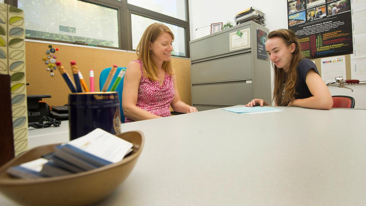 A student visits with an advisor to discuss her degree progress