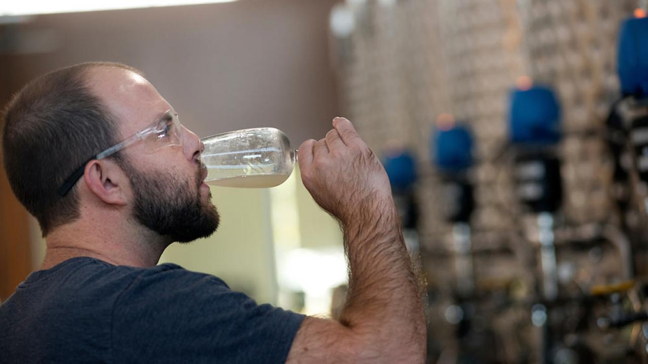 A UC Davis student sips his own ale creation in beer making class