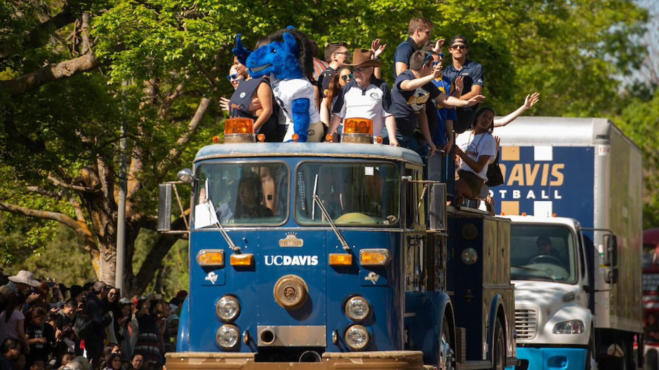 "Student ride on a custom made ""UC Davis"" fire engine in the annual Picnic Day parade"
