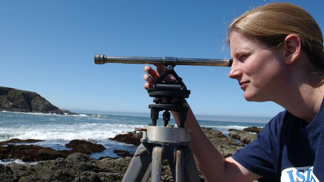 A female student surveys the shoreline near Bodega Bay