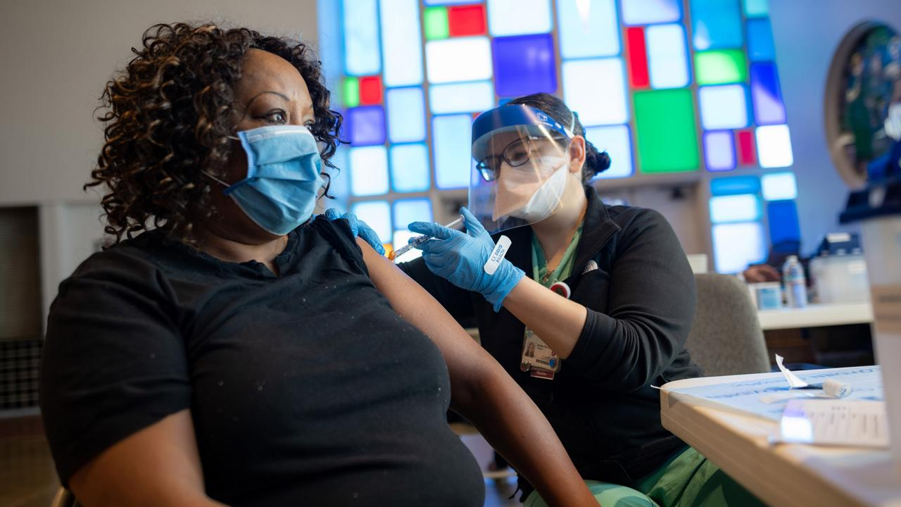 Woman receives vaccine in church.