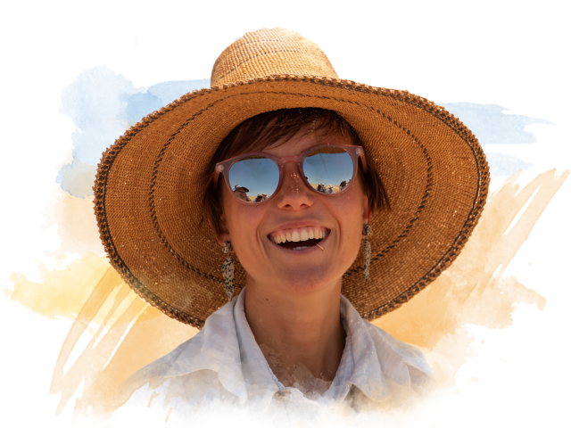 Young woman smiling with a sun hat on