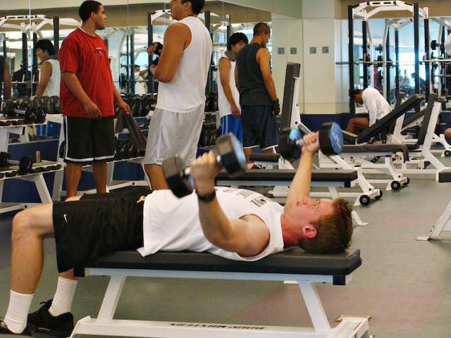 A male student works out in the UC Davis Activities and Recreation center weight room