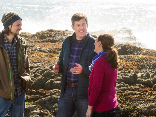 A professor discusses tidal pools with two students at the UC Davis Bodega Bay Marine lab