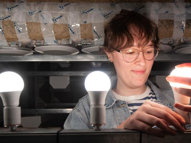 A female UC Davis researchers examines some new lighting technology