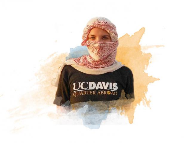 A female UC Davis student poses with a head scarf in Egypt