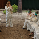 Dr. Tracey Goldstein instructs campers in Tyvek suits