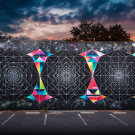 A mural featuring geometric shapes, both colorful and black-and-white.