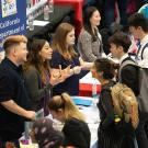 Students talk with employers at career fair