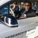 UC Davis Chancellor Gary S. May and BMW's Monterey Gardiner behind the wheel of an electric i3