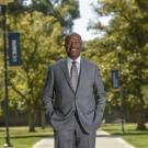 Chancellor Gary S. May, smiling, poses on Centennial Walk.