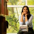 female student sitting in library