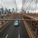One car drives across Brooklyn Bridge in New York during Spring 2020's shelter-in-place directives.