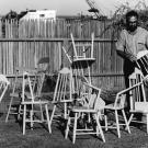 Photo: Ralph Johnson stages his artistic chairs.