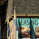 Apartment building with signs offering leases