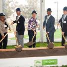 Officials from UC Davis shovel dirt during groundbreaking ceremony.