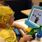 Deaf child taking EEG test