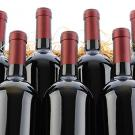 Photo: seven bottles of red wine
