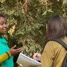 A PHD candidate discusses the Arboretum with students