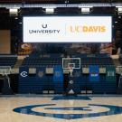 Videoboard hangs in The Pavilion, which will become the University Credit Union Center on july 1, showing the credit union logo and UC Davis wordmark.