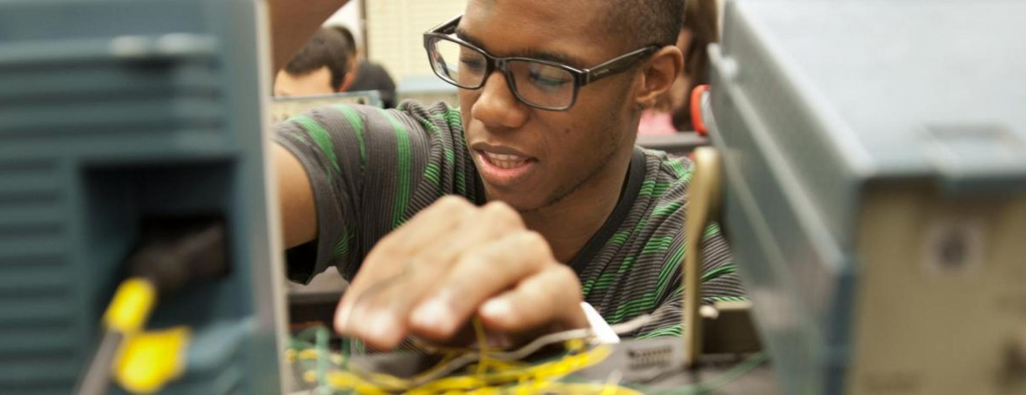 uc davis applied physics student works with circuits