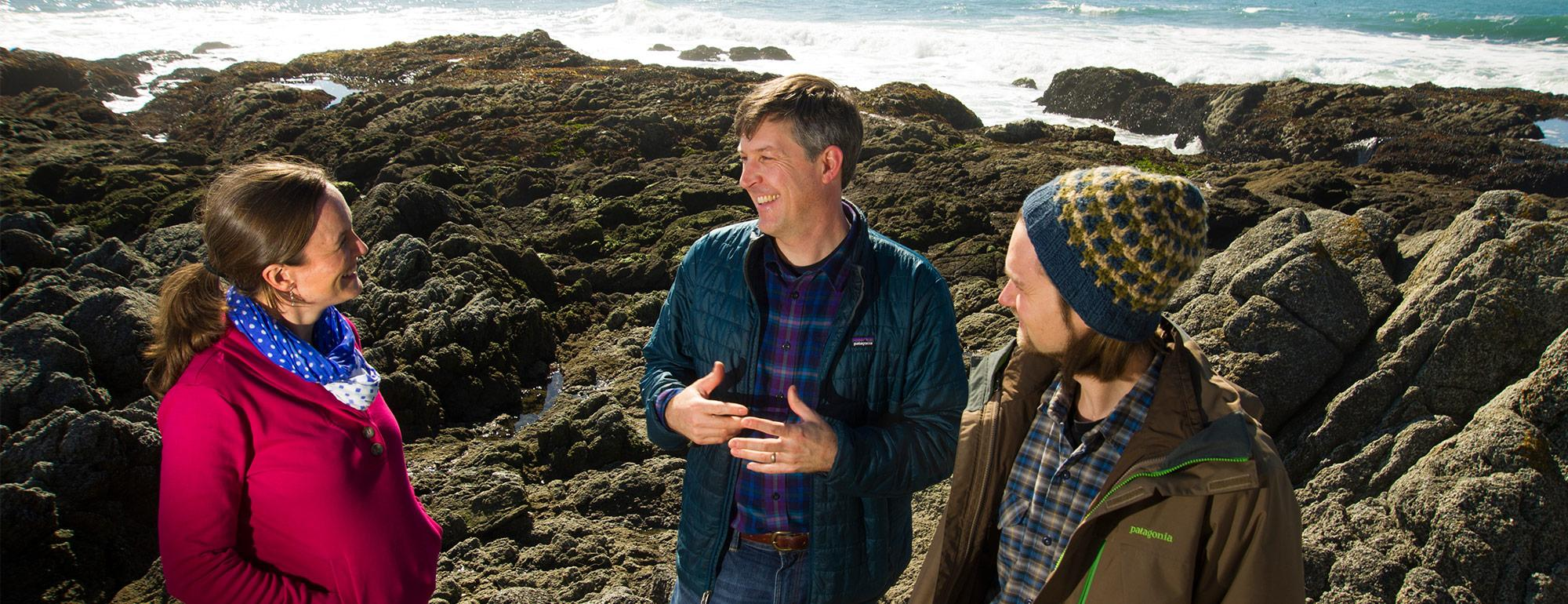 two students working with a professor on research at Bodega Bay Marine Lab
