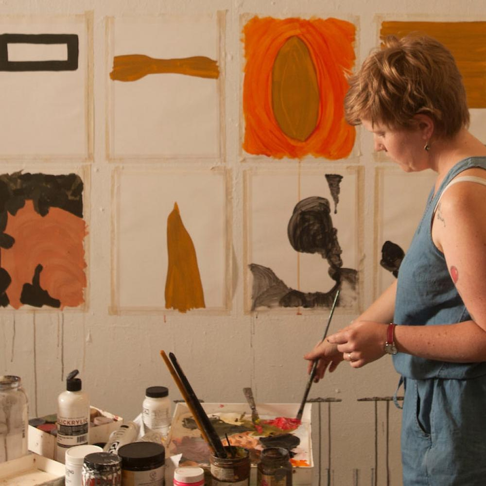 A student works on several paintings