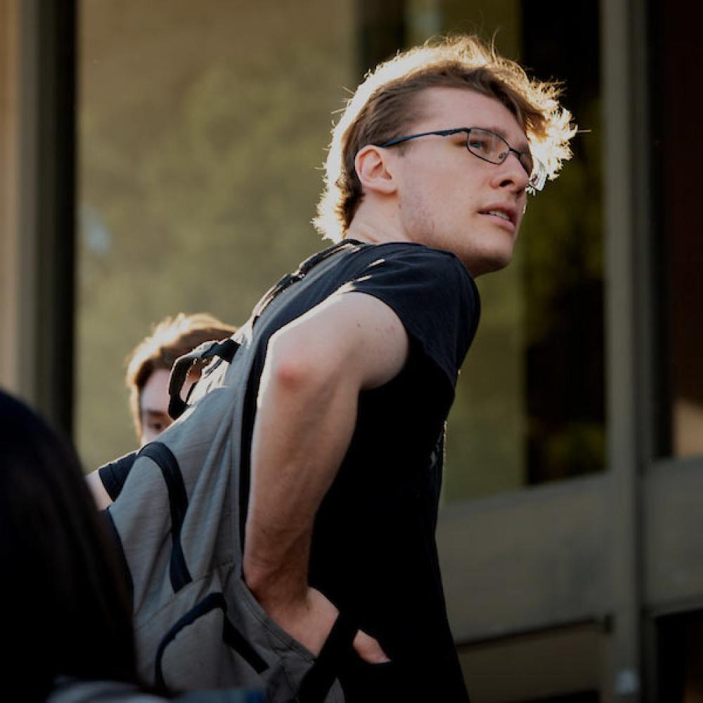 A male student looks back over his shoulder
