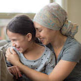 cancer patient holding her 8 year old daughter