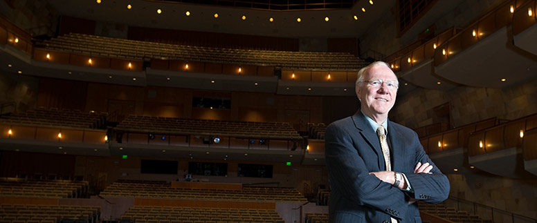 Larry Vanderhoef standing in the Mondavi Center performance hall