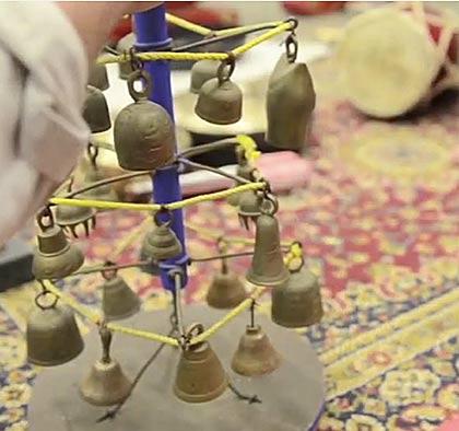 Hand near Javanese bells