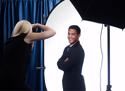 Man getting his taken by a professional female photographer