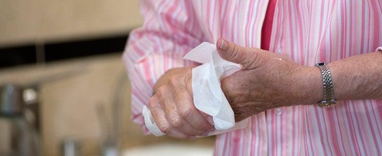 hands using a paper towel
