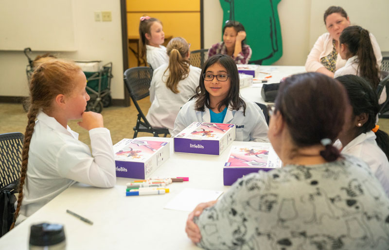 Girl Scouts interact with mentors