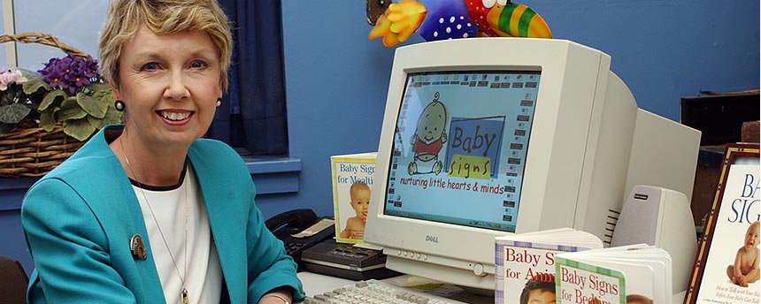 "Linda Acredolo at her desk with ""Baby Signs"" books"