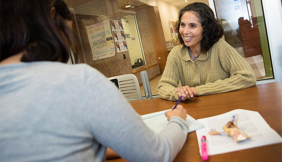 Woman counseling a student at the Student Community Center