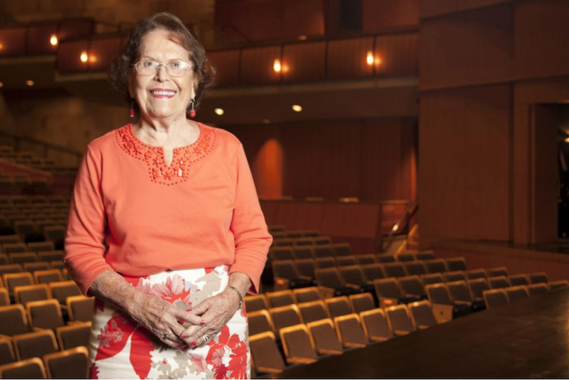 A photo of Barbara K. Jackson standing in the Mondavi Center's Jackson Hall.