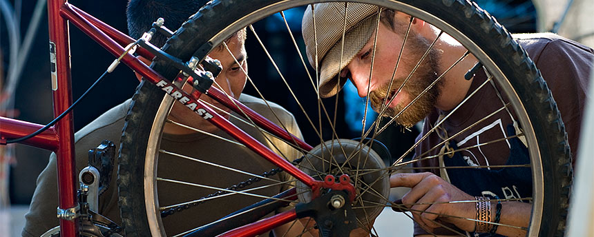 Two men fixing a bike