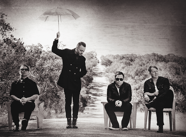 A promotional photo of the four members of the band Blue October.