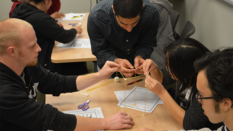 Students work with spaghetti and marshmallows for a team-building exercise