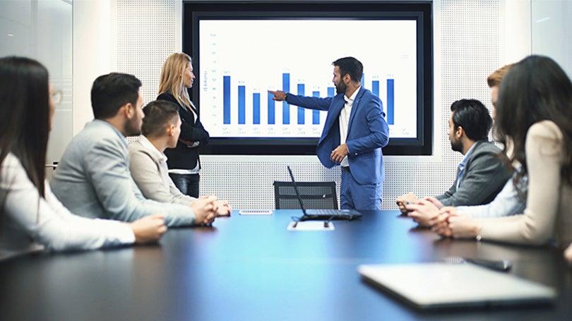 man presenting chart at meeting