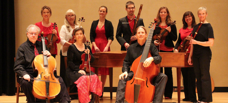 The Sacramento Baroque Soloists posing on stage with their instruments.