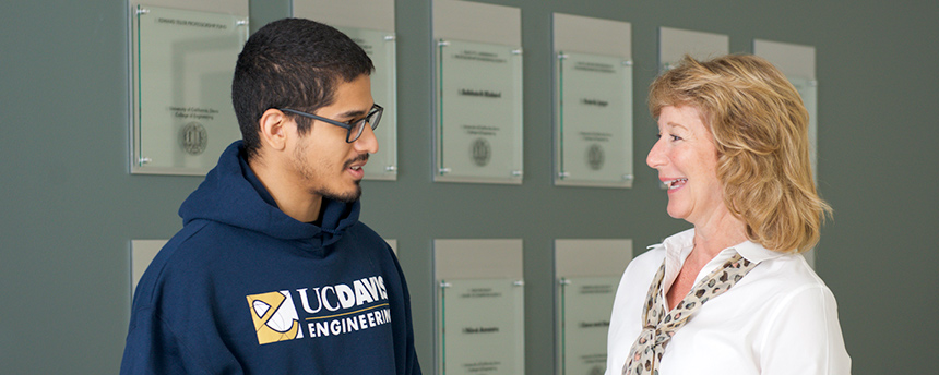 Dean Jennifer Sinclair Curtis, right, talking with a male student