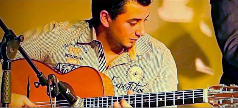 Amati Schmitt playing guitar.