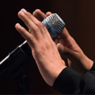 closeup of a microphone and hands