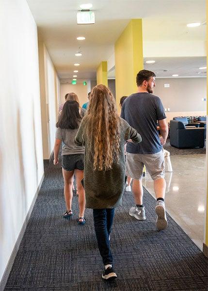 Four resident advisors in hallway