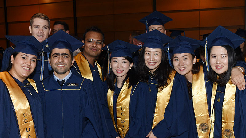 Several students from the Graduate School of management in an informal pose