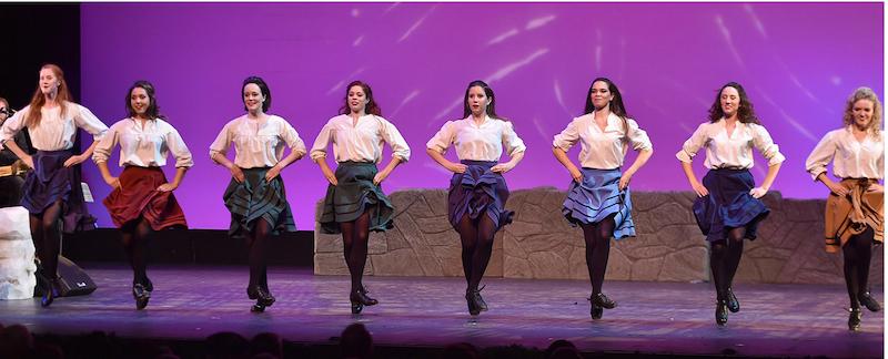 Irish dancers dancing on stage.