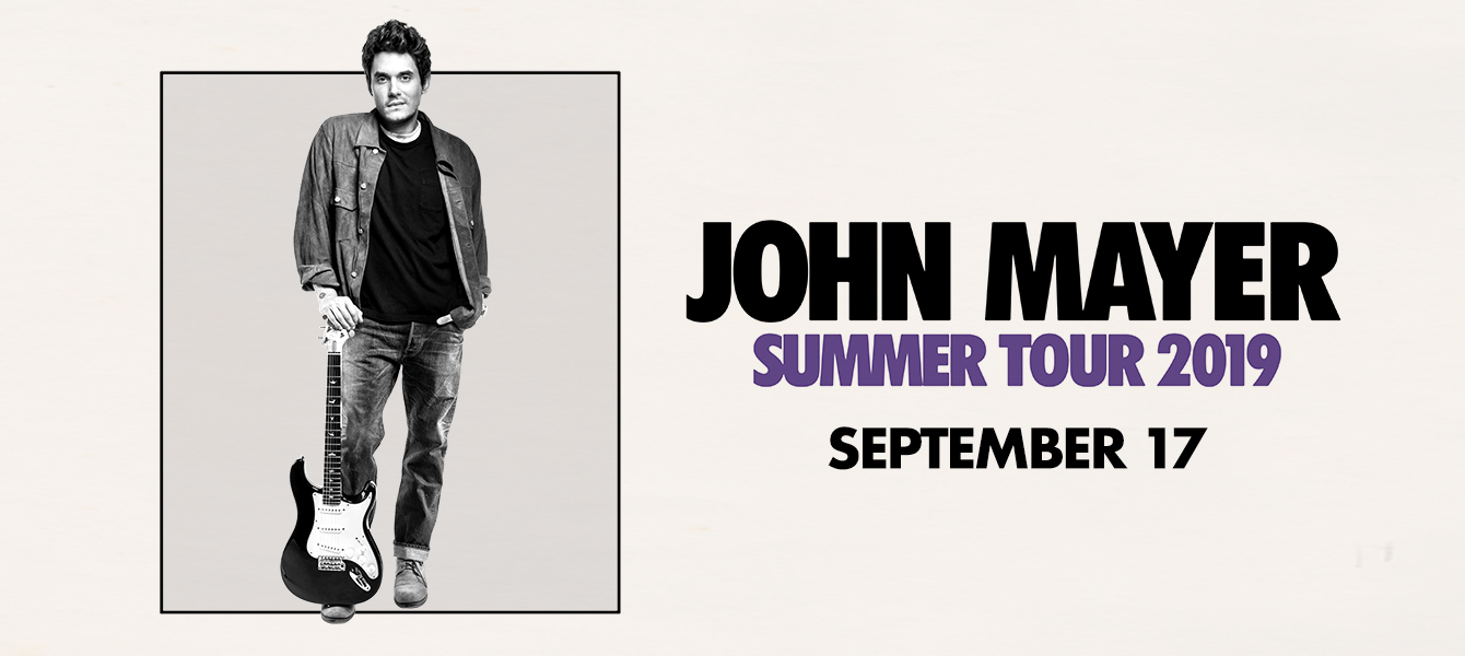 A promotional photo featuring John Mayer holding his electric guitar.