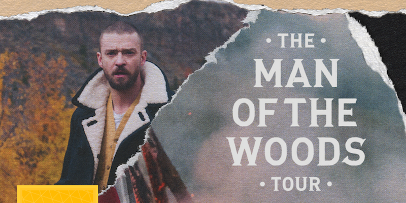 Promotional photo of Justin Timberlake standing in the woods.